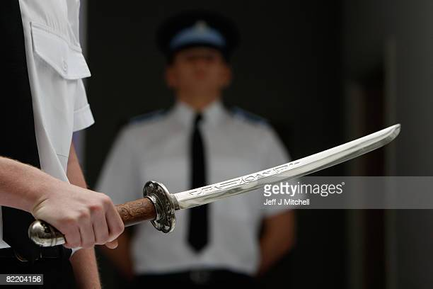 Police Cadet holds a dangerous weapon which has been seized as part of Strathclyde Police campaign against violence August 7 2008 in Strathclyde...