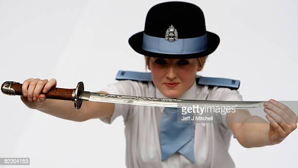 Police Cadet Holly McGhee holds a dangerous weapon which has been seized as part of Strathclyde Police campaign against violence August 7 2008 in...