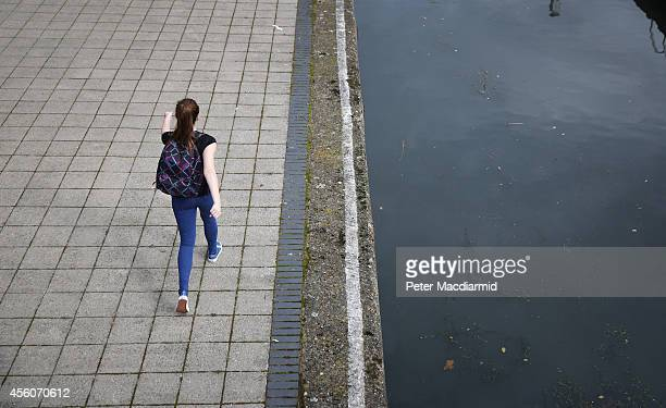 A police cadet reconstructs the last known movements of missing schoolgirl Alice Gross seen here walking past Brentford Lock on September 25 2014 in...