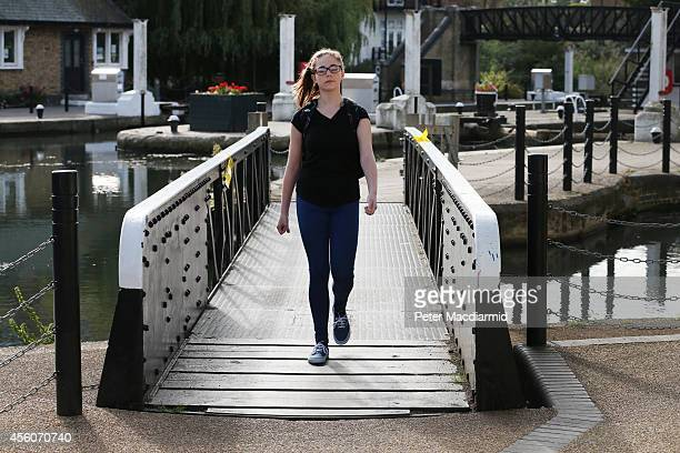 A police cadet reconstructs the last known movements of missing schoolgirl Alice Gross seen here walking over a bridge at Brentford Lock on September...