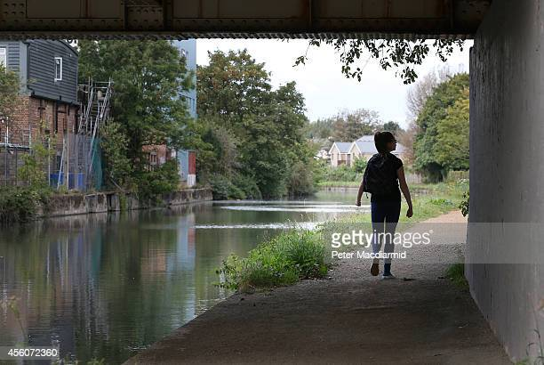 A police cadet reconstructs the last known movements of missing schoolgirl Alice Gross here she walks under a bridge on the Grand Union Canal the...