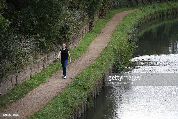 A police cadet reconstructs the last known movements of missing schoolgirl Alice Gross here she walks next to the Grand Union Canal the location of...