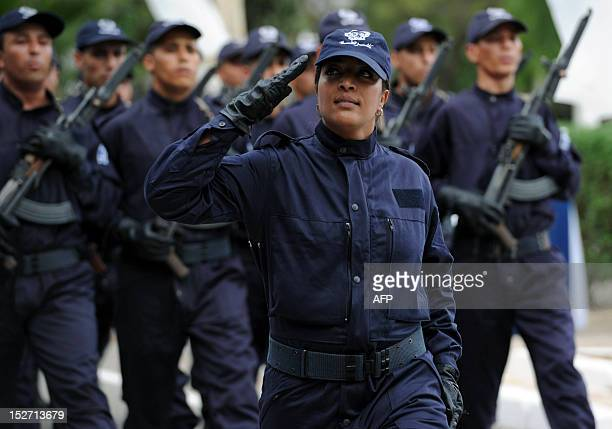 Police cadets parade during their graduation ceremony from the school of the National Security in Soumaa in the southern Algerian city of Blida on...