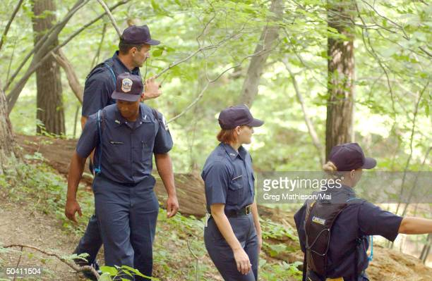 Police cadets searching the woods of Rock Creek Park for evidence following the disappearance of Washington intern Chandra Levy.