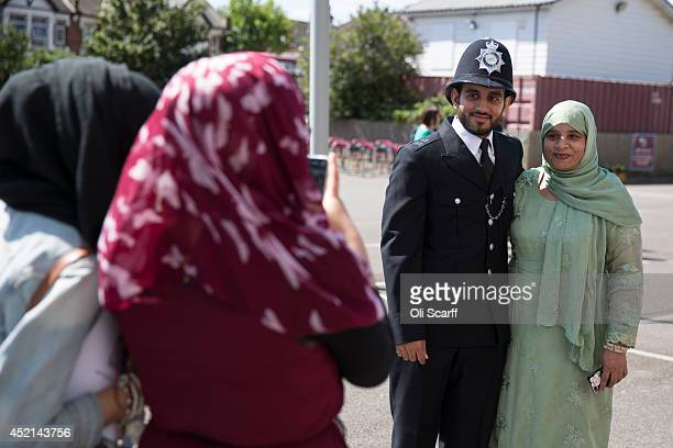 Police cadets who have completed their training celebrate with family members after taking part in their 'Passing Out Parade' in the grounds of West...