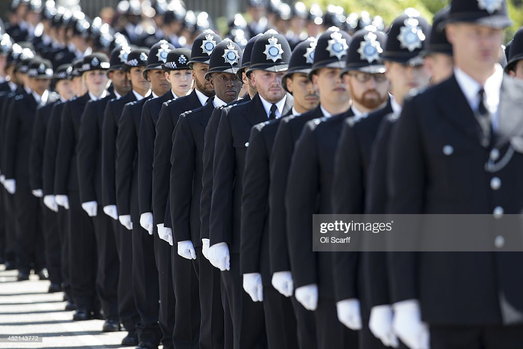 Police cadets who have completed their training take part in their 'Passing Out Parade' in the grounds of West Ham United Football Club on July 14, 2014 in London, England. 144 Metropolitan Police Service recruits took part in the parade in the presence of Boris Johnson, the Mayor of London, and the Met Police Commissioner Sir Bernard Hogan-Howe. The Metropolitan Police have announced that for the first time in its modern history they will recruit exclusively from Londoners to fill the ranks of new police constables. It was the second time the Passing Out Parade had taken place in a public space away from the Metropolitan Police's Hendon Training School.