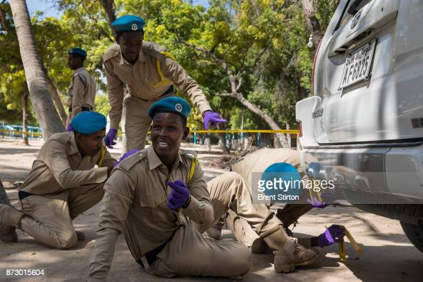 Police candidates attend a crime scene investigation class in Mogadishu. As well as classroom lessons, on this day they are also seen conducting a...