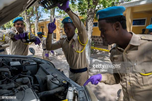 Police candidates attend a crime scene investigation class in Mogadishu As well as classroom lessons on this day they are also seen conducting a...