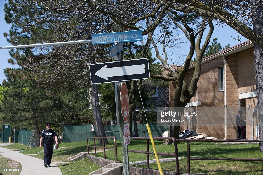 Police canvas the housing complex beside John Garland Blvd  where