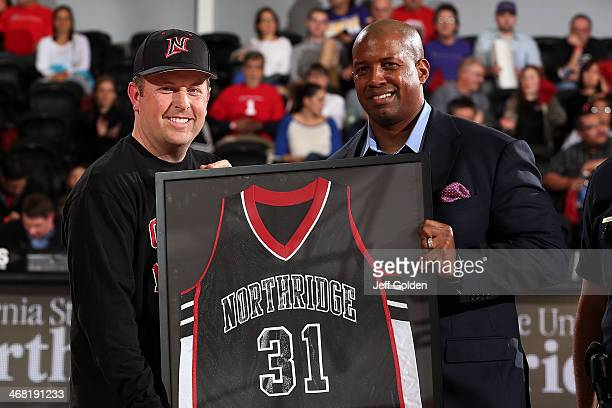 Police Captain Scott VanScoy accepts a framed jersey from CSUN Athletic Director Brandon Martin on behalf of Chief of Police Anne P Galvin at...