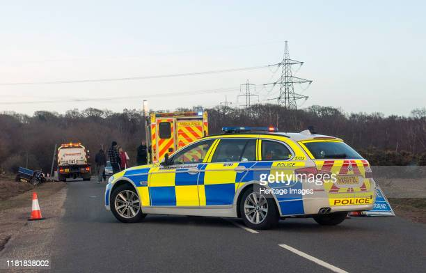 Police car and ambulance attending road traffic accident 2018. Creator: Unknown.