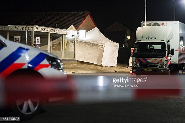 A police car and tent are seen outside a jewellery in Deurne The Netherlands late on March 28 2014 after two presumed robbers were killed by a...