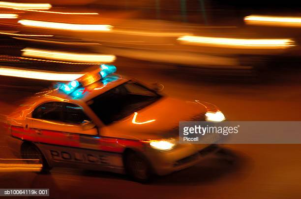police car at night, blurred motion - police car stock photos and pictures
