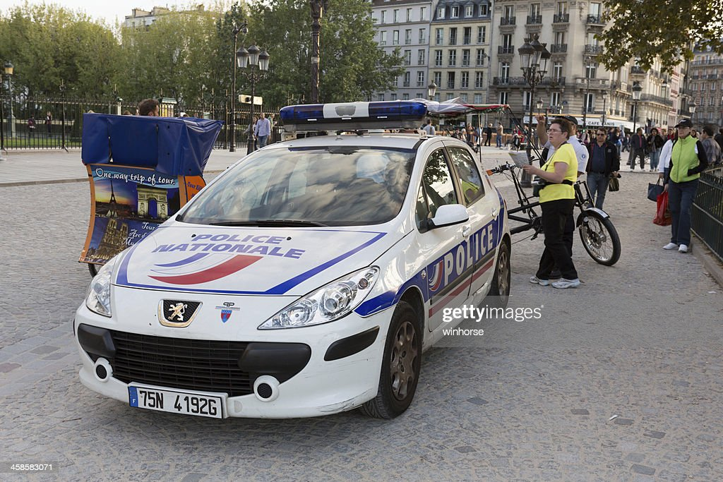 Police Car At Notre Dame Cathedral In Paris France Stock Photo