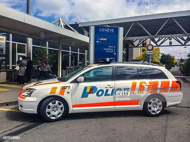 police car  at the entrance to geneva airport - genève zwitserland stockfoto's en -beelden