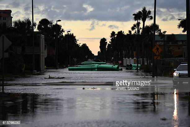 A police car blocks a flooded street in Jacksonville Beach Florida on October 8 after Hurricane Matthew passed the area A weakened Hurricane Matthew...