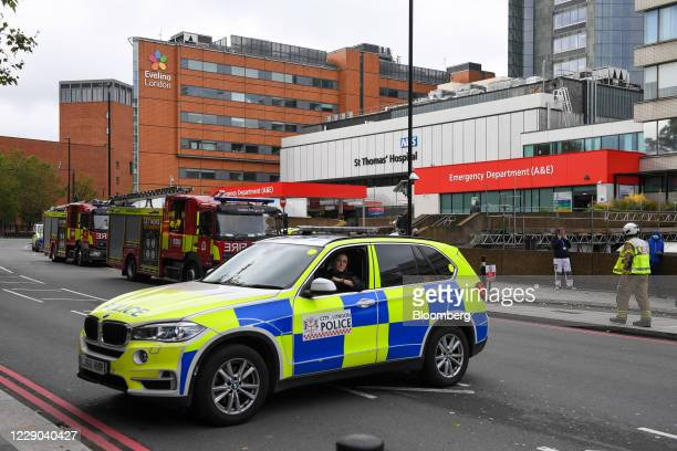 Police car blocks a road outside St. Thomas' Hospital in London, U.K., on Tuesday, Oct. 13, 2020. Lambeth Police says there are dealing with a...