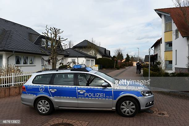 A police car blocks a small street on March 26 in Montabaur soutwestern Germany from where the copilot of the crashed Germanwings plane came...