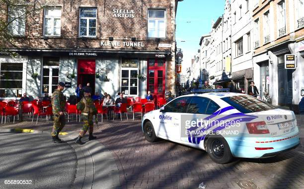 A police car blocks access to the Meir Antwerp's main pedestrian street after a man was arrested after he tried to drive into a crowd of shoppers at...