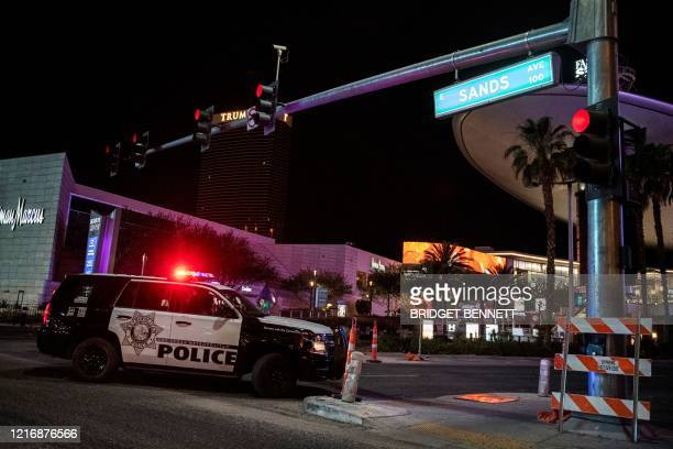 Police car blocks Las Vegas Boulevard along the Strip after a shooting was reported outside Circus cirucus hotel and casino, on June 1 in downtown...