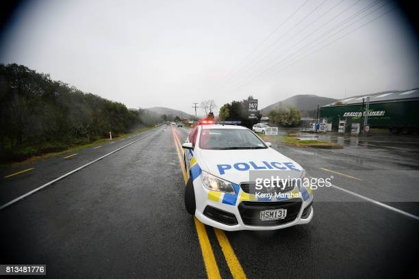 A police car blocks the road as contractors close SH5 between Napier and Taupo on July 13 2017 in Napier New Zealand Snow is falling across the South...
