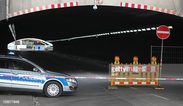 A police car blocks the tunnel the entrance to the Loveparade in Duisburg western Germany on July 25 2010 At least 19 people were killed and more...