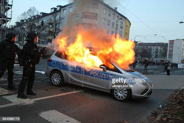 A police car burn after being set on fire by anticapitalist protesters near the European Central Bank building in Frankfurt