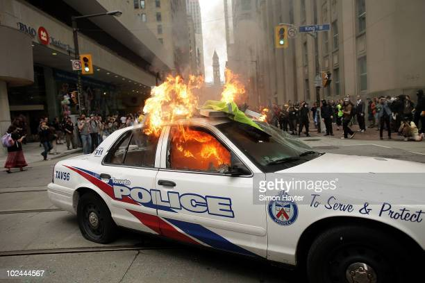 Police car burns after violent anti-G20 protesters, using Black Bloc tactics, smashed their way through downtown streets June 26, 2010 in Toronto,...