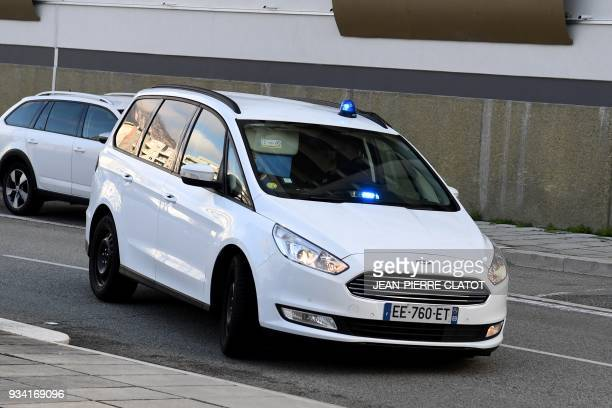 A police car carrying Nordahl Lelandais chief suspect in the case of the disappearance of Maelys an eightyearold French schoolgirl who vanished from...