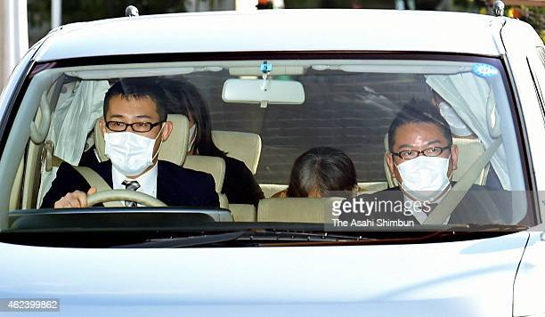 A police car carrying suspect Chisako Kakehi arrives at a detention facility of Osaka Prefecture Police on January 28 2015 in Osaka Japan Kakehi...