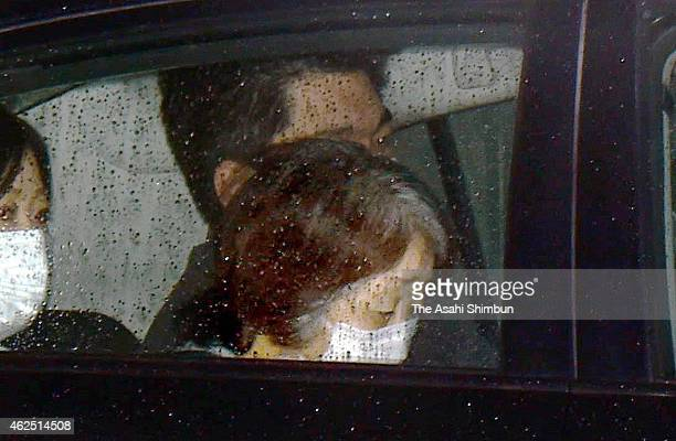A police car carrying suspect Chisako Kakehi leaves a detention facility of Osaka Prefecture Police to be sent to the Osaka Prosecutors' Office on...