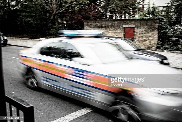 Police car chase, blurred motion in city street