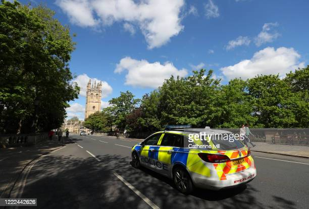 A police car drives along the empty High Street infront of Magdalen College on May 02 2020 in Oxford England British Prime Minister Boris Johnson who...