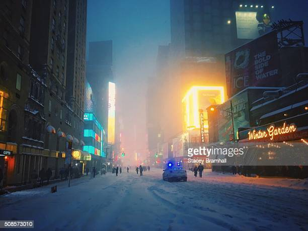 A police car drives down 7th Avenue towards Times Square during the 2016 blizzard