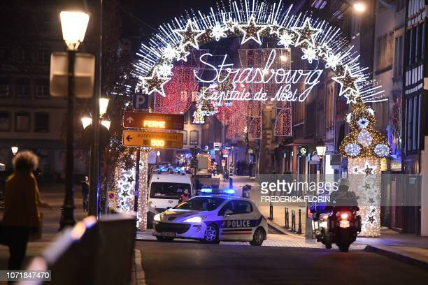 TOPSHOT A police car drives in the streets of Strasbourg eastern France after a shooting breakout on December 11 2018 At least two people have been...