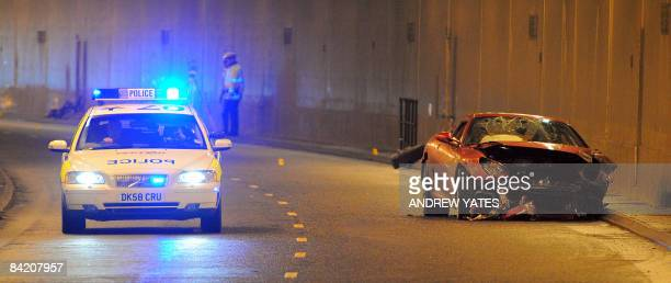 A police car drives past a crashed ferrari car belonging to Manchester United's Cristiano Ronaldo in a tunnel near Manchester Airport in Manchester...