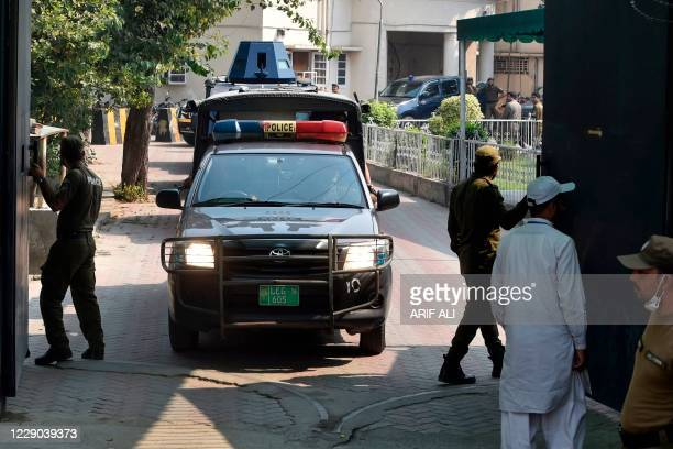 Police car escorts an armed vehicle carrying a suspect of a gang rape as they leave the court premises in Lahore on October 13, 2020. - A Pakistani...