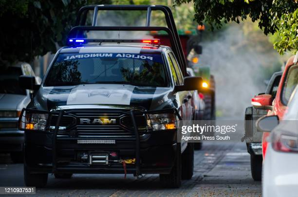 Police car escorts the truck that disinfects the streets of Minatitlán, Municipality of Colima on April 24 in Colima, Mexico. Mexico started what the...