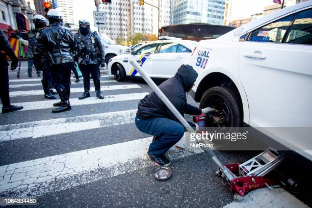 A police car has a flat tire prepared on the sidelines of the Thanksgiving Day Parade in Philadelphia November 22 2018 Thousands of spectators turn...