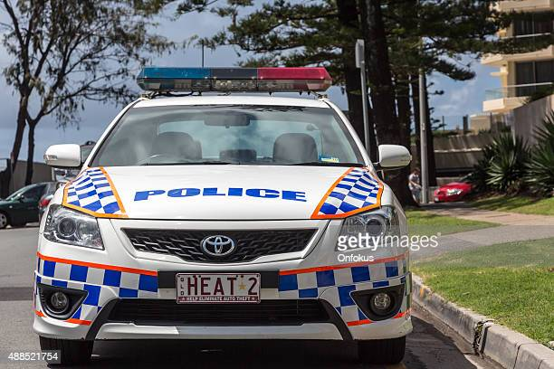 police car in broadbeach on the gold coast of australia - queensland stock pictures, royalty-free photos & images