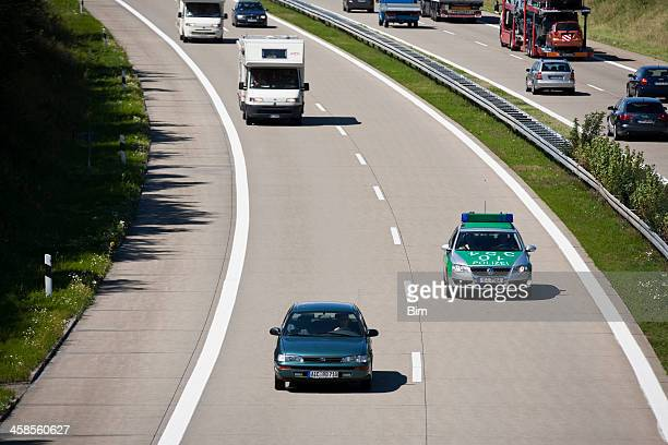 Police Car in Traffic on Highway, A7 Autobahn, Germany