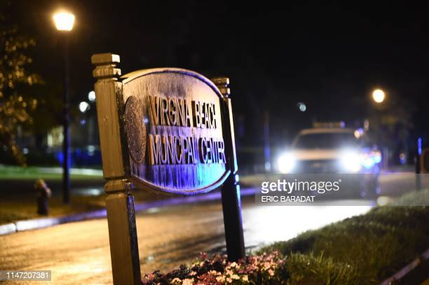 A police car is parked controlling access to the Virginia Beach municipal center the site of a mass shooting in Virginia Beach Virginia on May 31...