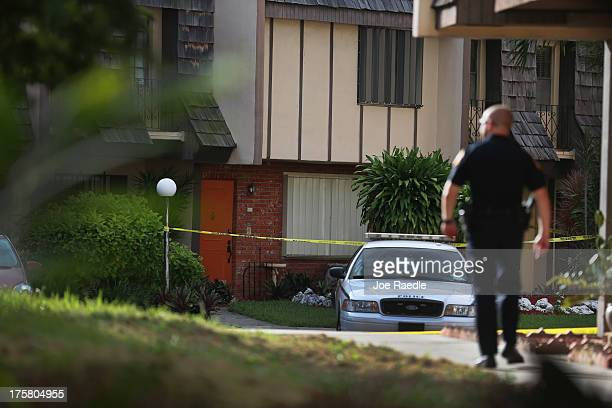 A police car is parked in front of a townhouse where seemingly a husband reportedly confessed on Facebook to murdering his wife on August 8 2013 in...