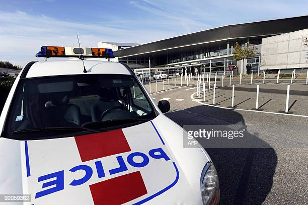 Police car is parked on October 20, 2009 in front of Mulhouse hospital where German doctor Dieter Krombach might be detained after having been found...