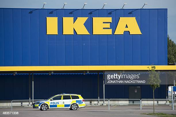 A Police car is parked outside IKEA store in the city of Vaesteraas about 100 km west of Stockholm on August 10 2015 Two people were stabbed to death...