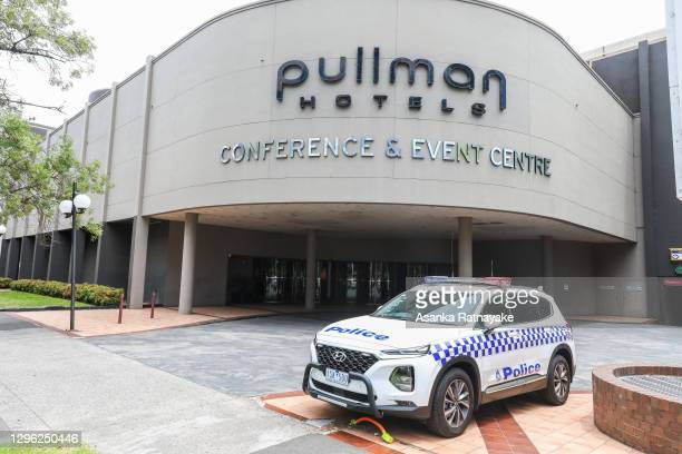 Police car is seen at the back entrance of The Pullman Hotel in Albert Park which is one of the three hotels being used for quarantine of players and...