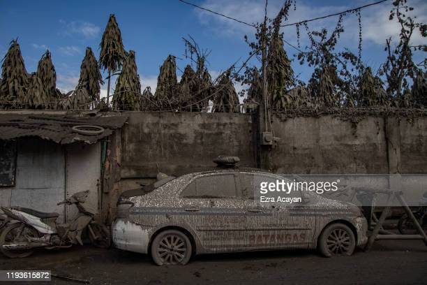 A police car is seen covered in volcanic ash from Taal Volcano's eruption on January 14 2020 in Talisay Batangas province Philippines The Philippine...