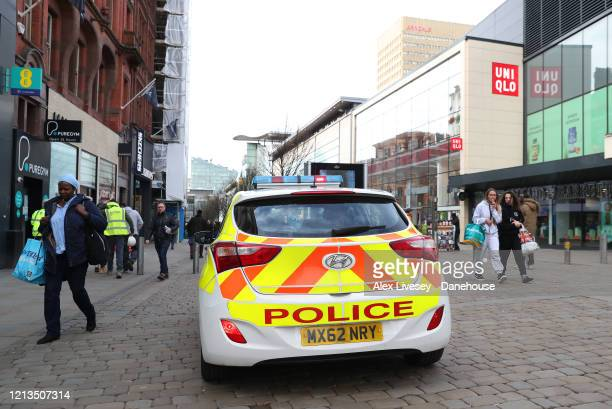A police car is seen in the shopping centre of Manchester as the UK adjusts to life under the Coronavirus pandemic on March 19 2020 in Manchester...