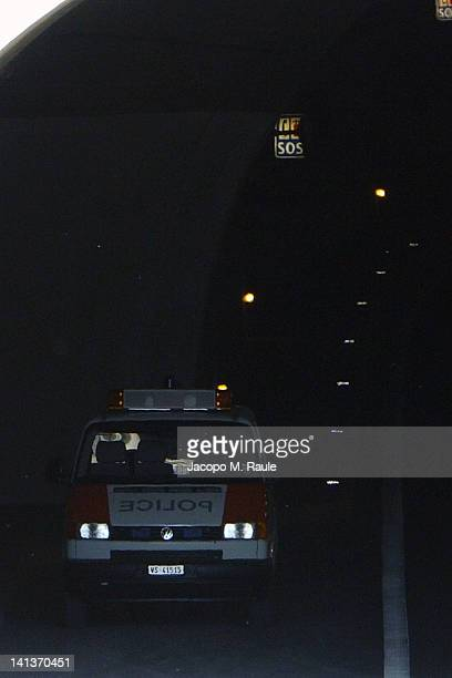 Police car is seen inside the tunnel where 22 school children and 6 adults died in a bus crash on March 15 2012 in Sierre Switzerland The accident...