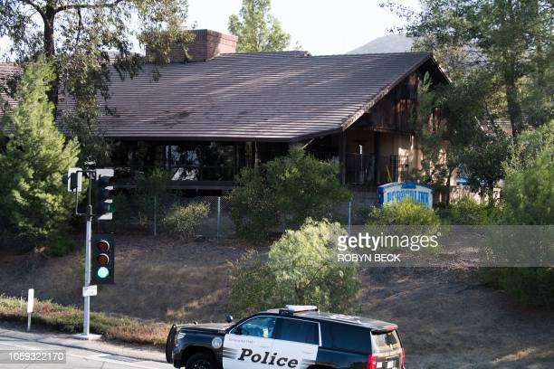 Police car is seen near the scene of a mass shooting at the Borderline Bar & Grill in Thousand Oaks, California, November 8, 2018. - A 28-year-old US...